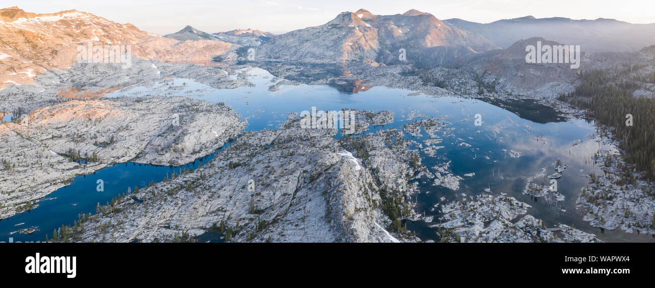 The scenic Sierra Nevada mountain range in California is made up of 100 million year old granite that were sculpted by glaciers over geologic time. Stock Photo