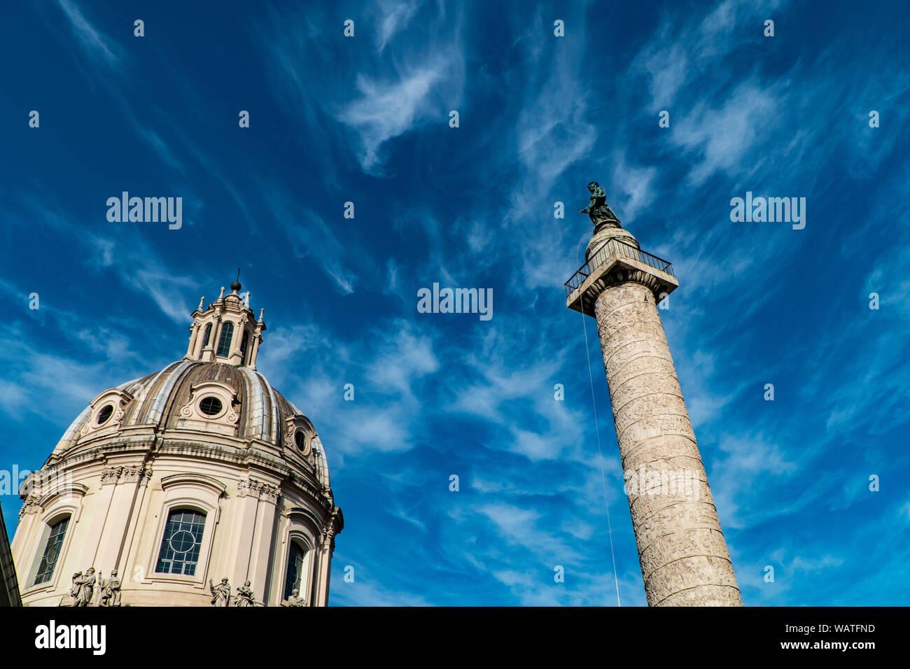 Trajan's Column (Colonna Traiana) in Rome, Italy and Chiesa del Santissimo Nome di Maria Stock Photo
