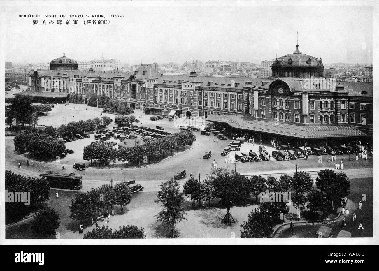[ 1930s Japan - Tokyo Station ] —   Tokyo Station, Tokyo. Located in the Marunouchi business district of Tokyo, near the Imperial Palace grounds and the Ginza commercial district, the building was designed by architect Tatsuno Kingo to celebrate Japan's victory in the Russo-Japanese War.   The station opened on December 20,  1914. In 1921, Prime Minister Takashi Hara was assassinated here.  20th century vintage postcard. Stock Photo