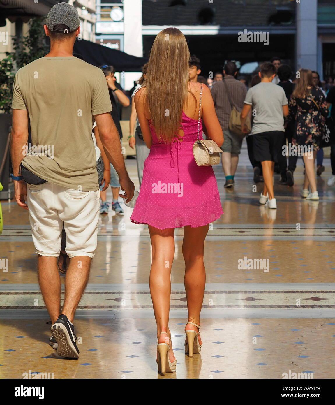 Fashionable couple walking in Vittorio Emanuele gallery, Milan. Stock Photo