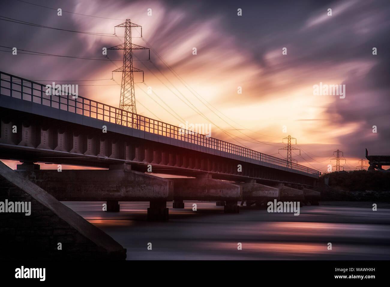 Loughor estuary rail bridge sunset Stock Photo