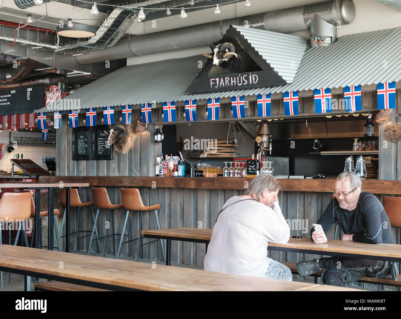 Street food stalls at the Grandi Matholl Food Hall in the old harbour district of Reykjavik, Iceland Stock Photo