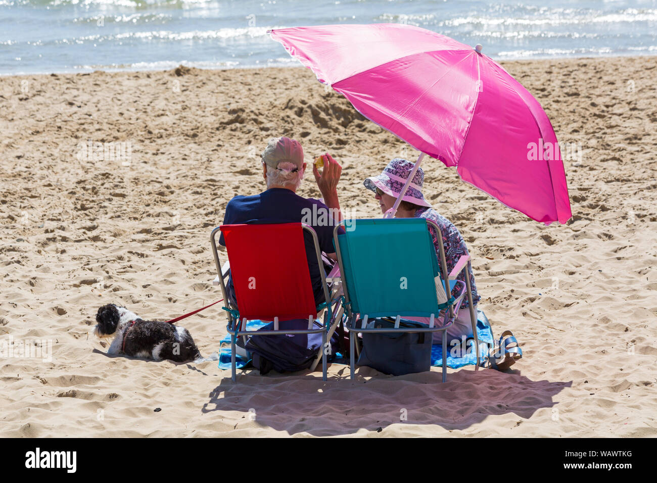 Bournemouth, Dorset UK. 22nd Aug 2019. UK weather: a lovely warm sunny day as beachgoers head to the seaside at Bournemouth beaches to enjoy the sunshine, as temperatures are set to get higher for the Bank Holiday weekend. Credit: Carolyn Jenkins/Alamy Live News Stock Photo