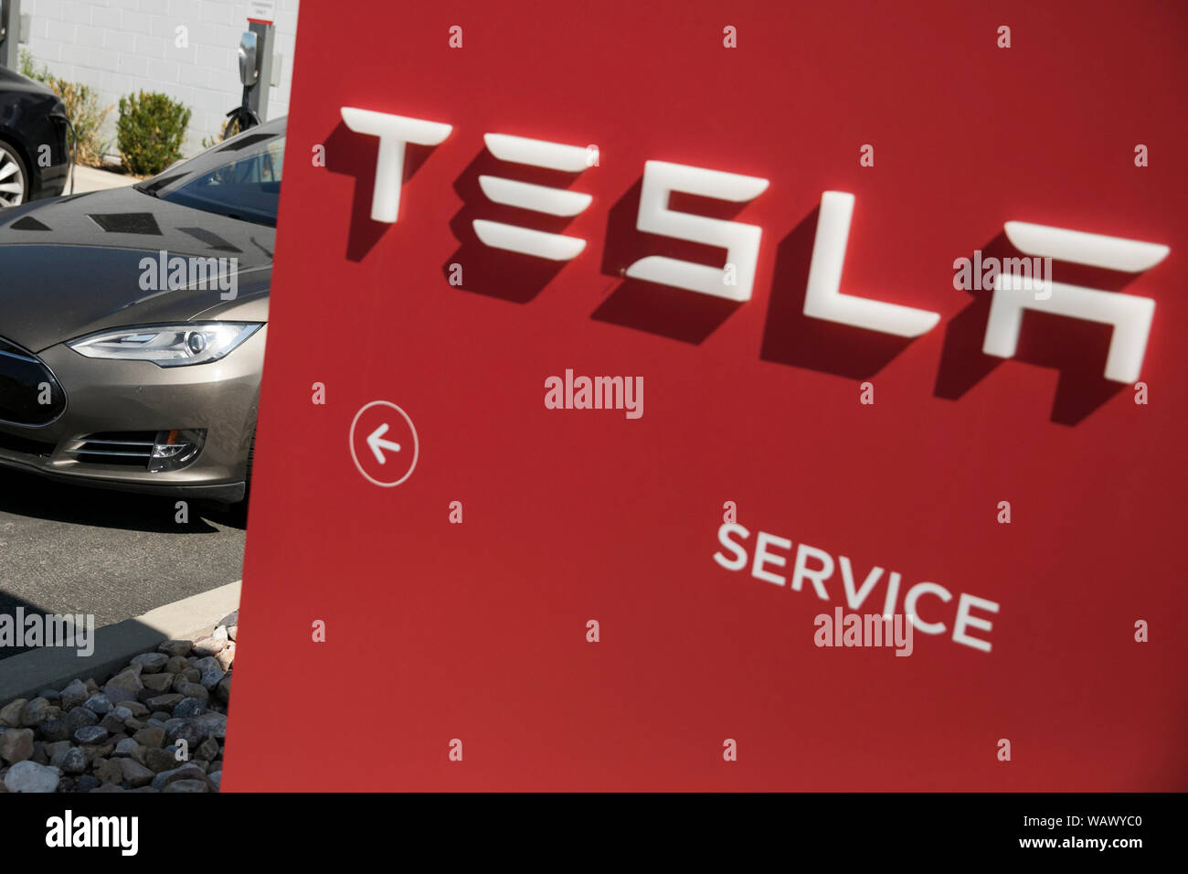 Car Dealerships In Utah >> A Logo Sign Outside Of A Tesla Car Dealership In Salt Lake
