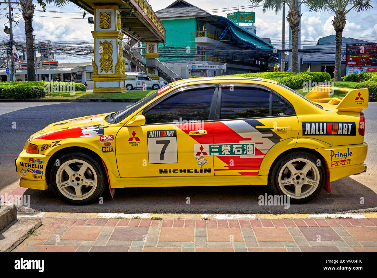 Mitsubishi Lancer yellow car. Race prepared modified sports saloon Stock Photo