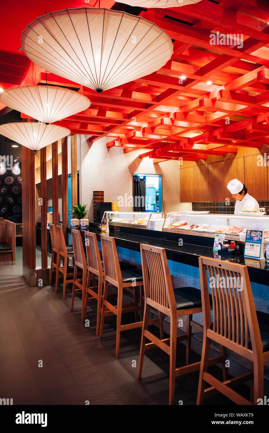 Oct 30 2013 Bangkok Thailand Vibrant Japanese Sushi Restaurant Interior Chef Working At Shushi Bar With Wooden High Chairs Stock Photo Alamy