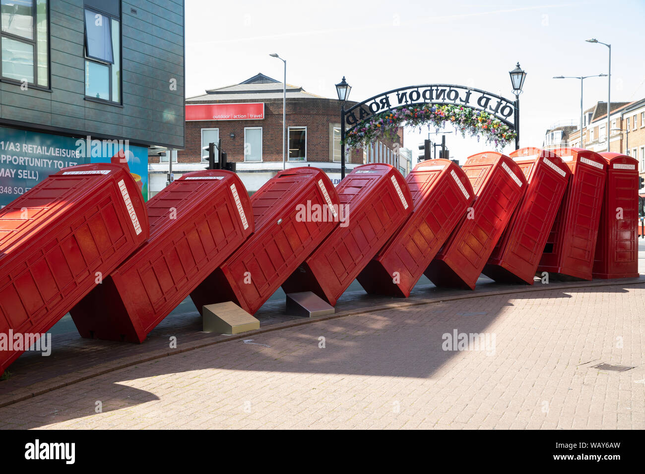 12 telephone boxes toppled over like dominoes is symbolic of Kingston Upon Thames, Surrey. Out of Order, by David Mach, arrived in 1989. Stock Photo