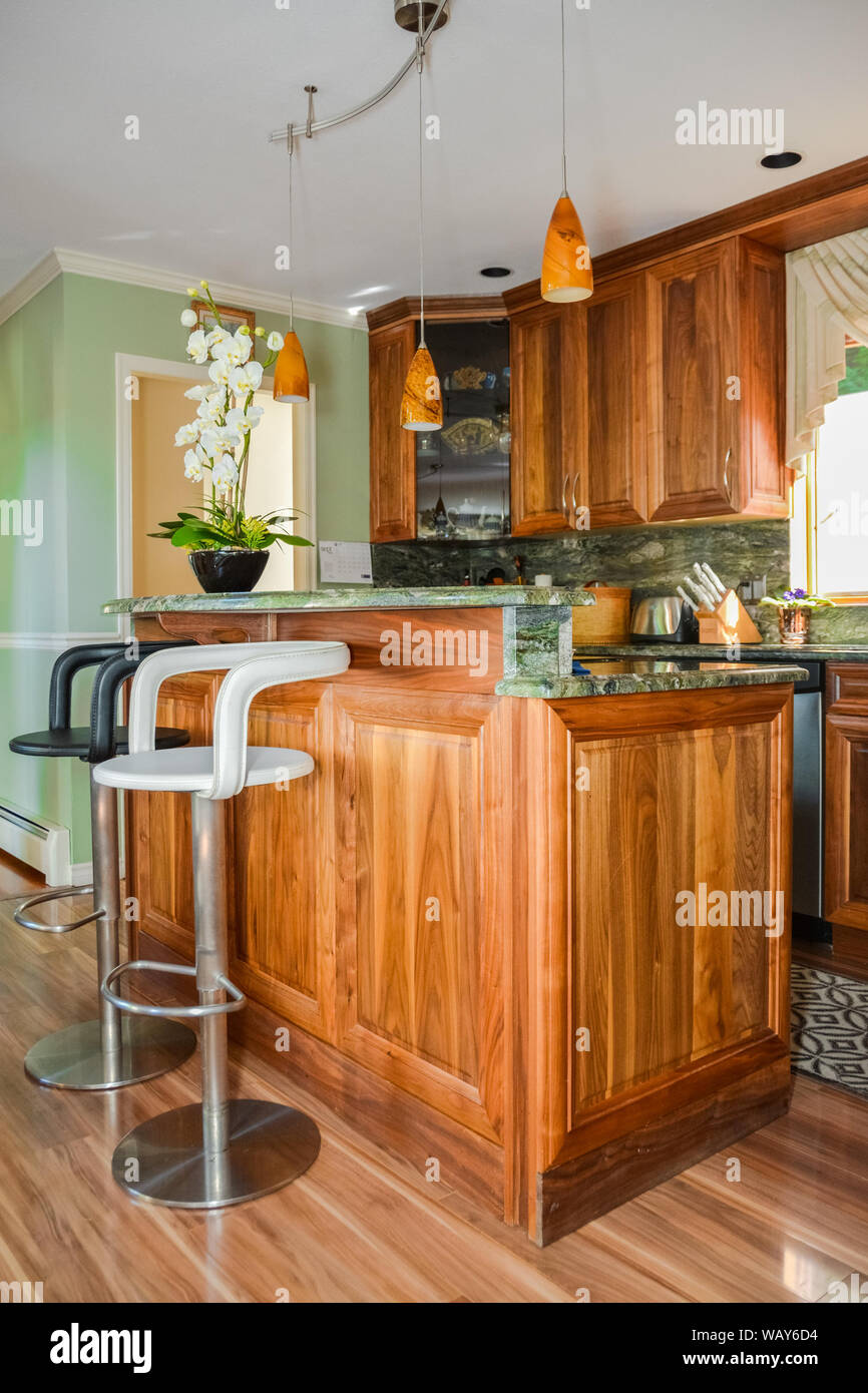 Stylish Kitchen Wooden Interior With High Chairs Beside The Island Table Stock Photo Alamy