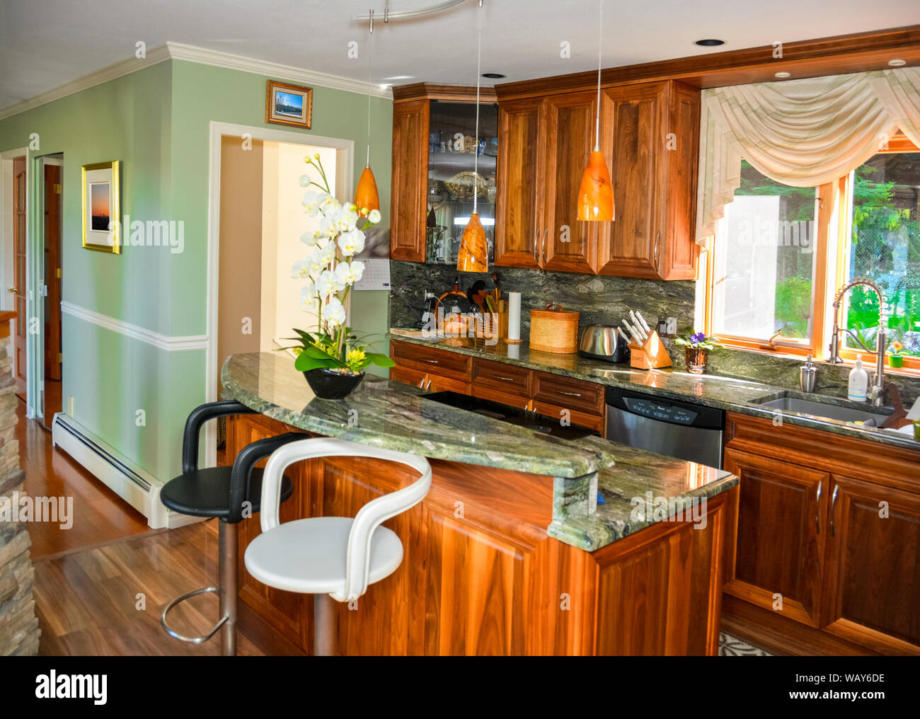 Stylish Kitchen Wooden Interior With Island Table With Two Chairs Beside Stock Photo Alamy
