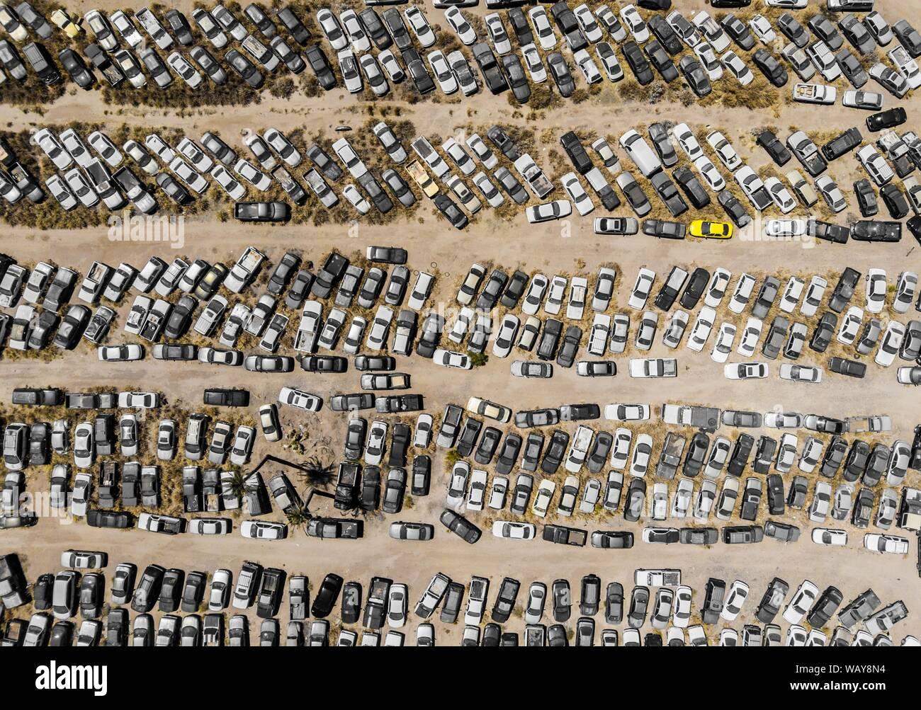 Aerial view of cars in the corralón, municipal corralón, cars stopped,Vista aerea de autos en el corralón, corralón municipal, automóviles detenidos. Hermosillo. Sonora. Photo: (NortePhoto / LuisGutierrez) keywords: aerial, aerial, aerial photo, aerial photography, urban, urbanity, city, many, lines, rectangle, rectangles, geometry, several, car, cars, motoring, cars, lanscape, urban landscape, luz de dia, daylight, aerial, aerea, aerial photo, aerial photography, urban, urbanidad, ciudad,  muchos, lineas, rectángulo, rectángulos, geometria, varios, car, cars, automovilismos , automóviles, lan Stock Photo