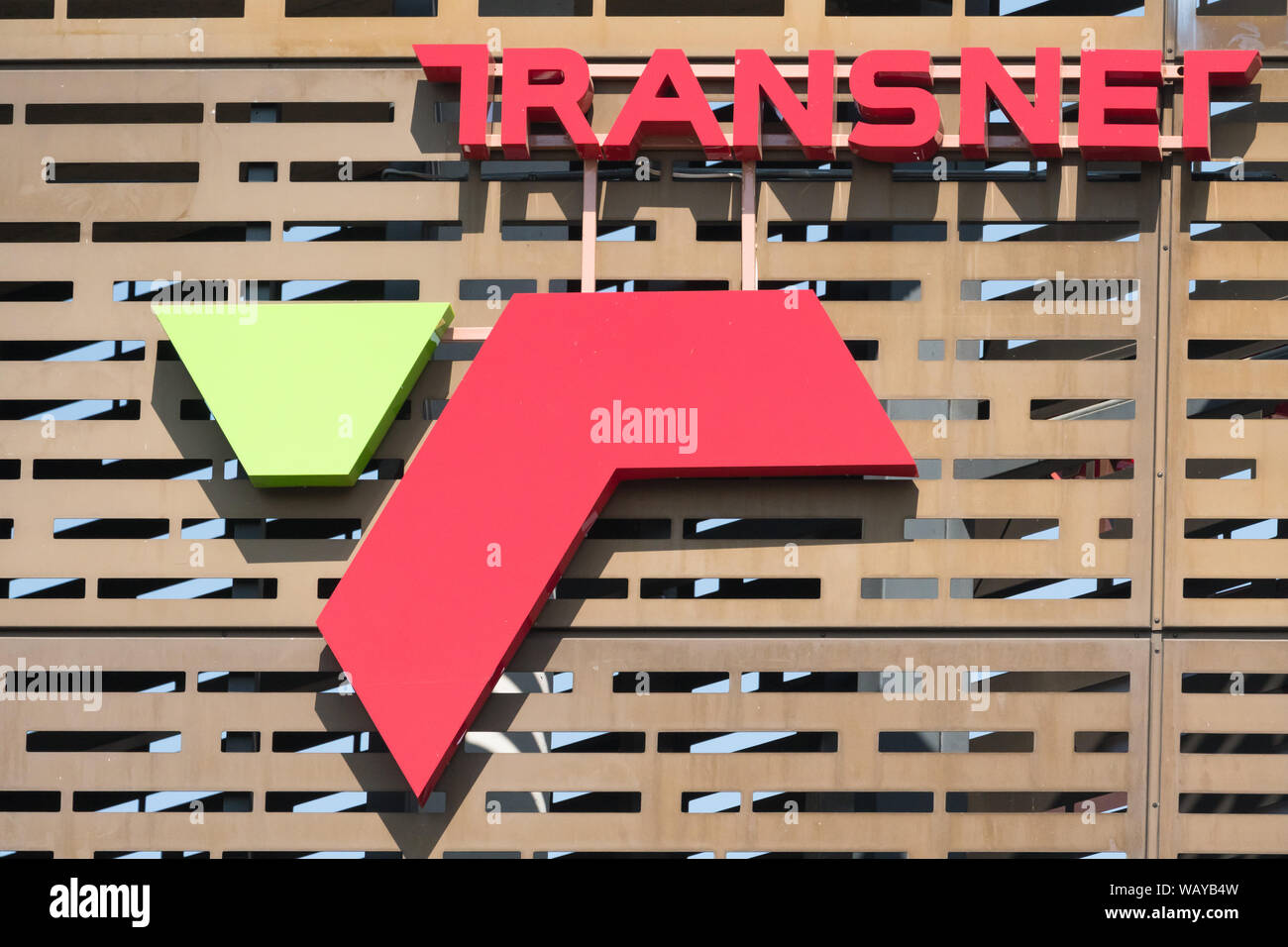 Transnet signage or sign in eye catching bright colourful letters on the side of a building in Johannesburg, Gauteng, South Africa Stock Photo