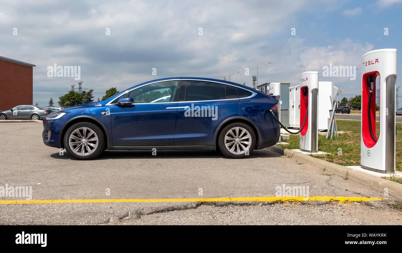 Full-view of Tesla Model X supercharging at Tesla