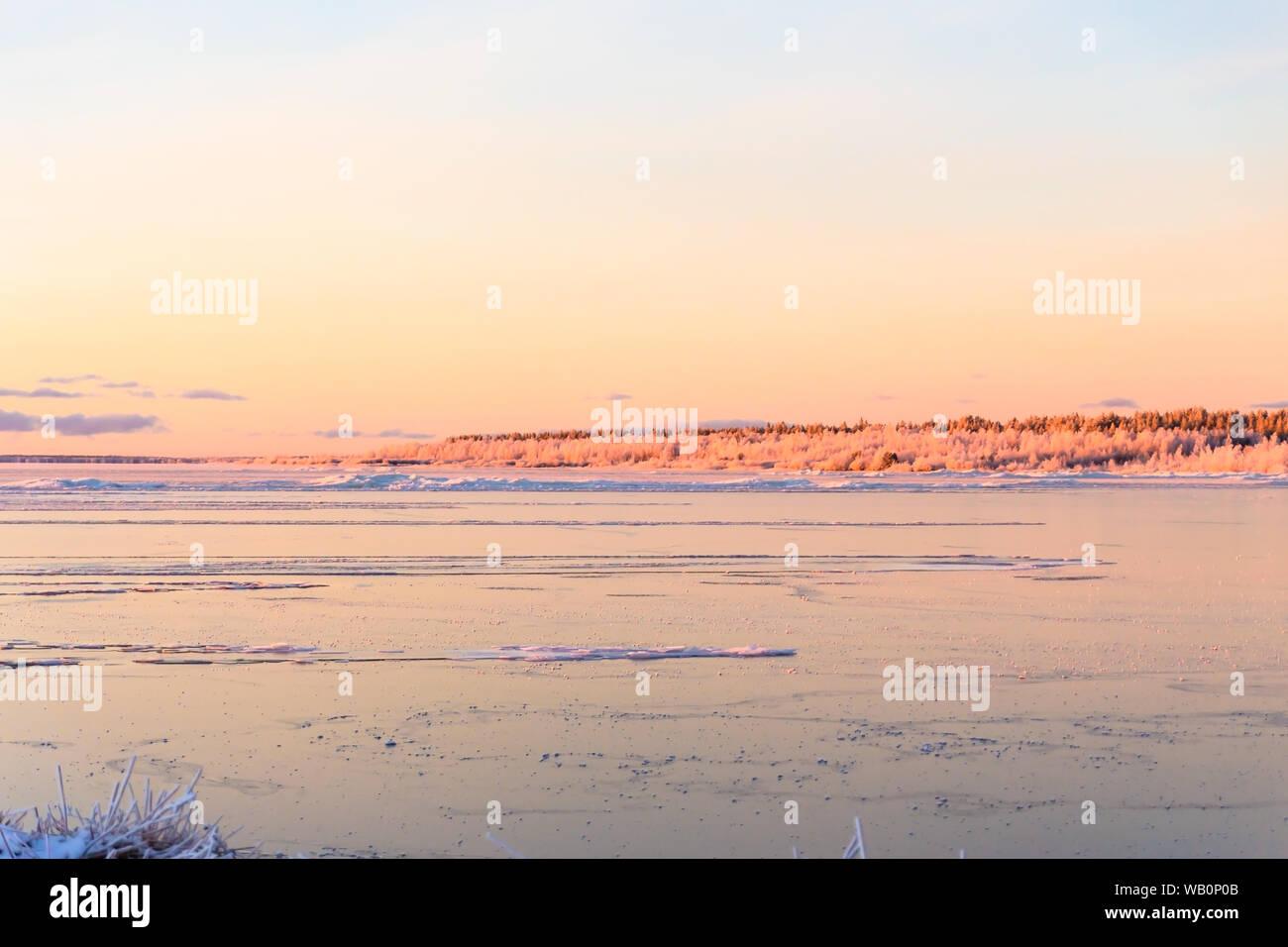 Winter time sea is frozen and frosty beach landscape,Hailuoto island,Bothnian Bay,North Ostrobothnia, Finland Stock Photo