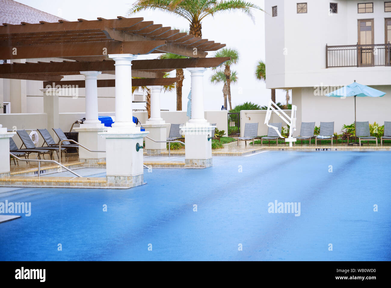 Swimming pool with lounge chairs Stock Photo