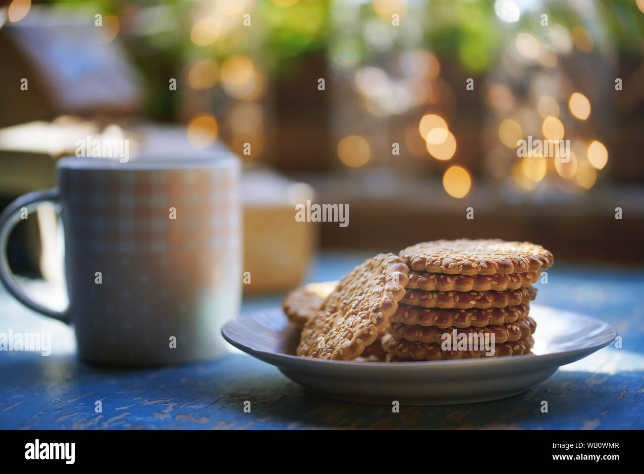 Teacup and Christmas gluten free cookies on a table near the window Stock Photo