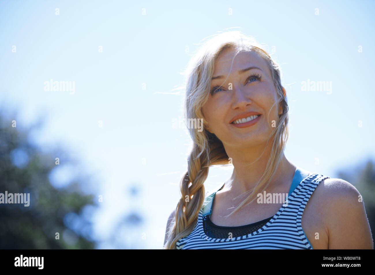 Happy woman enjoying outdoors Stock Photo