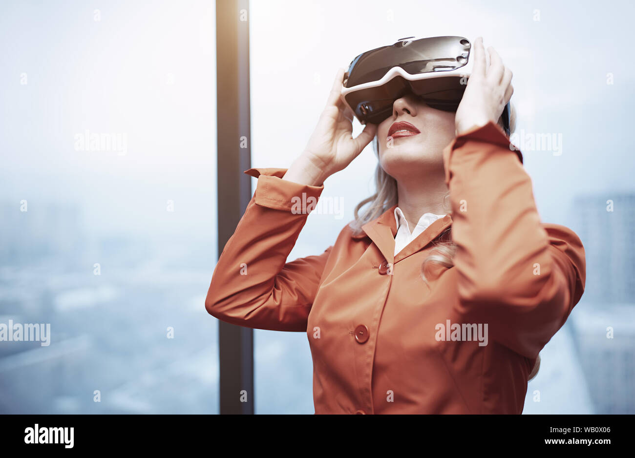 Woman at office wearing Virtual reality headset Stock Photo