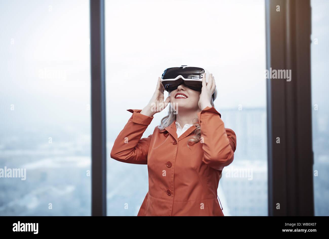 Woman at office wearing Virtual reality headset Stock Photo