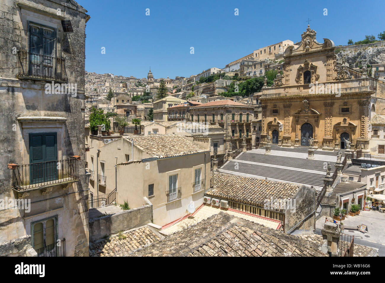 Looking across to San Pietro church and the historic center of Modica,  a Unesco World Heritage listed site. South eastern Sicily. Italy. Stock Photo