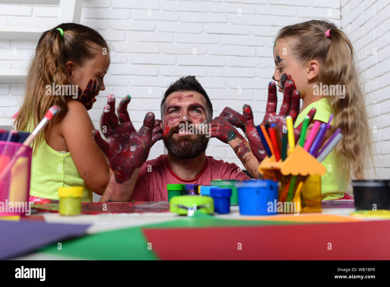 Fathers Day And Family Concept Body Art And Painting Daughters And Dad With Painted Hands Creativity And Imagination Girls Drawing On Man Face Ski Stock Photo Alamy