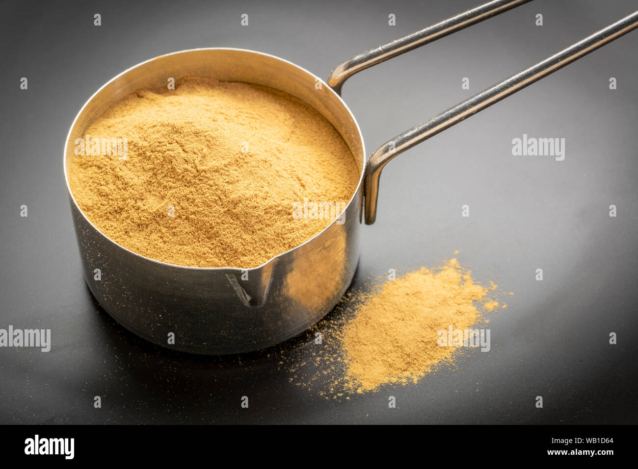 Green Coffee Beans Powder In A Metal Measuring Scoop Stock Photo