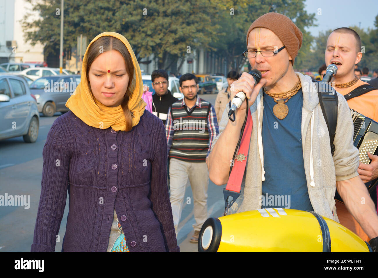 Iskcon temple devotees singing of hymns in praise of Lord krishna at connaught Place Stock Photo