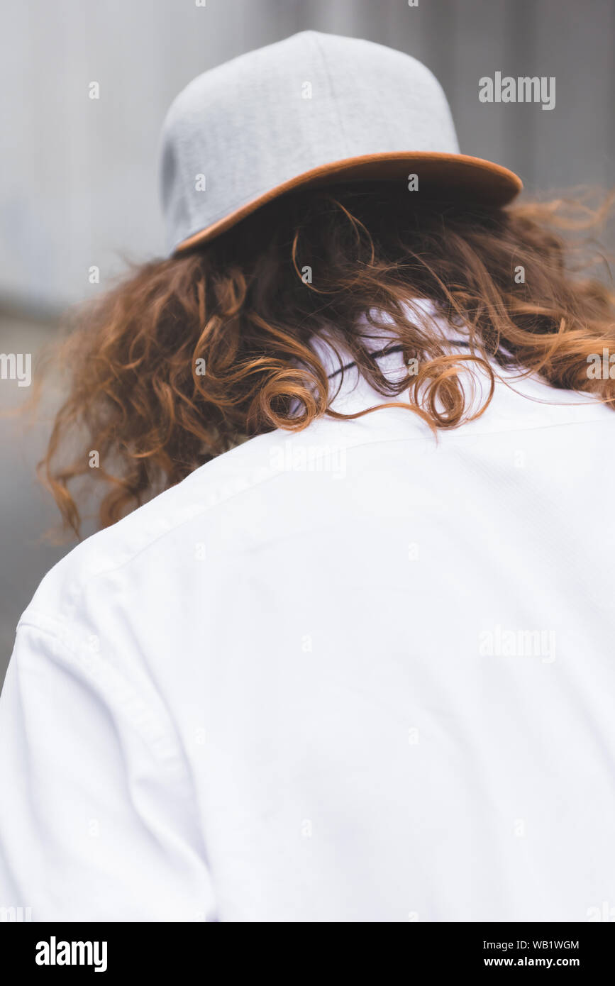 Back View Of Man With Curly Hair In Cup And White Shirt Stock Photo Alamy