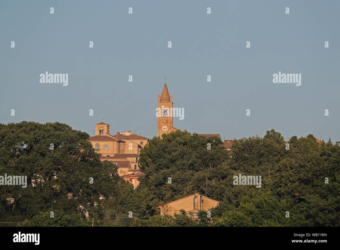 clock tower on the church in the Medieval village of Montecassiano  in the Marches or Le Marche region of central Italy near the town of Macerata Stock Photo