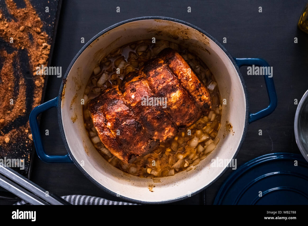 Flat Lay Cooking Boneless Pork Roast In Enameled Cast Iron Covered Dutch Oven Stock Photo Alamy