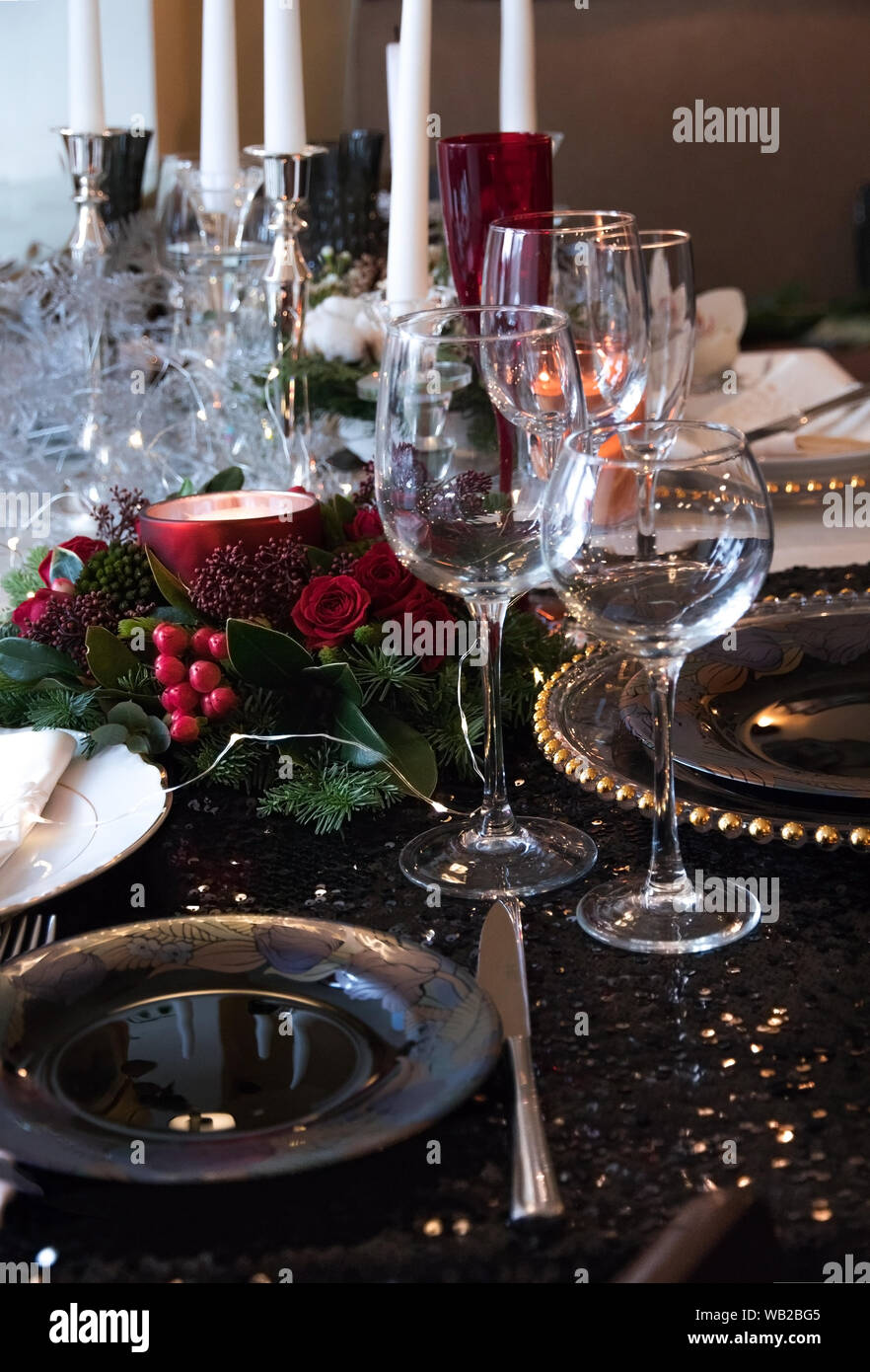 Christmas Composition Of Fir Branches Berries And Candles On The Table Festive Table Setting For Christmas Dinner On A Shiny Black Tablecloth And Ex Stock Photo Alamy