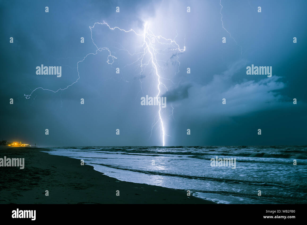 Bright lightning bolt strikes in the North Sea during a summer thunderstorm Stock Photo