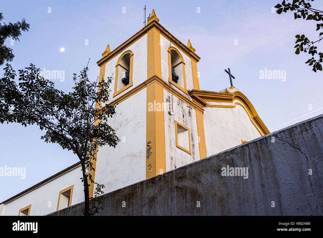 Bell tower of Nossa Senhora da Imaculada Conceicao Church, at Lagoa da Conceicao neighborhood, built in 1751. Florianopolis, Santa Catarina, Brazil. Stock Photo