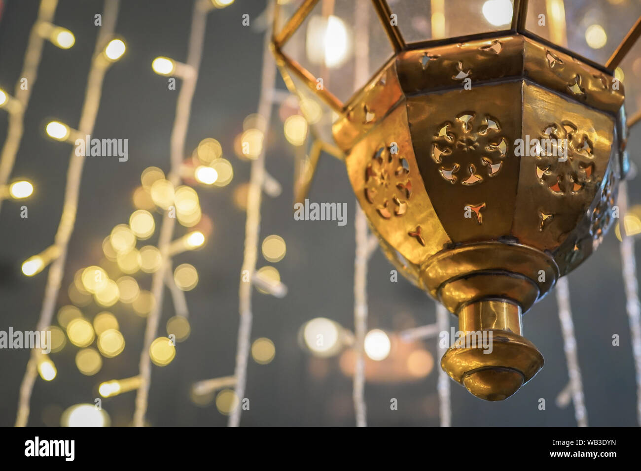 Hanging Arabic lantern with lights background. Stock Photo