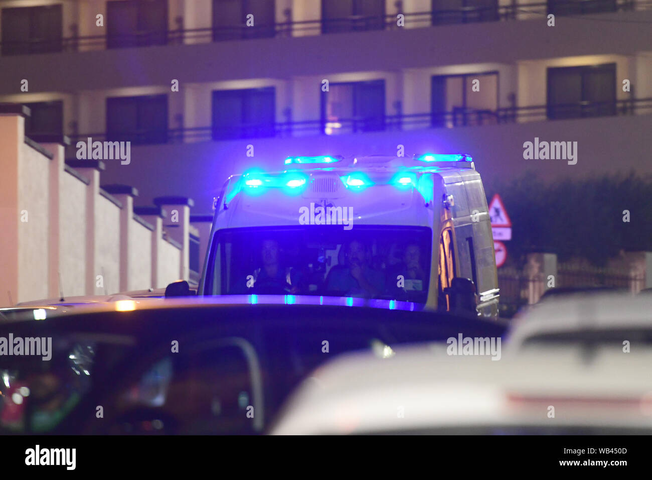 Floriana, Malta. 23rd Aug, 2019. An ambulance moves to the army's Hay Wharf base in Floriana, Malta, Aug. 23, 2019. The Maltese government confirmed that 356 migrants were brought to Malta Friday night on board of a patrol vessel of the Maltese Armed Forces (AFM) after they were transferred from the Norwegian-flagged charity ship Ocean Viking two weeks ago. Credit: Jonathan Borg/Xinhua Credit: Xinhua/Alamy Live News Stock Photo