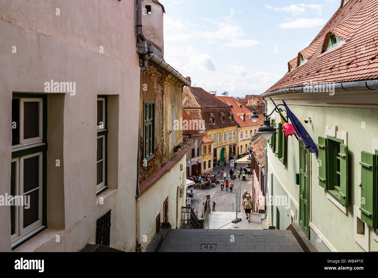 Sibiu, Romania - 2019. People wandering on the streets of Sibiu (old town). Streets with colorful houses. Stock Photo