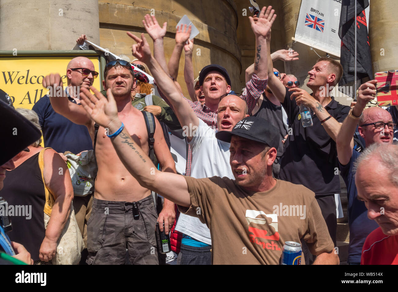 London, UK. 24th Aug, 2019. Tommy Robinson supporters protest at the BBC. They claim he is in jail for journalism. He was sentenced to 9 months for 3 offences outside Leeds Crown Court which could have led to the collapse of a grooming gang trial, and has previous convictions for violence, financial and immigration frauds, drug possession and public order offences. Police kept the two groups apart. Robinson supporters were later joined by marchers from Trafalgar Square, and a larger group from Stand Up to Racism came to join Antifa. Credit: Peter Marshall/Alamy Live News Stock Photo