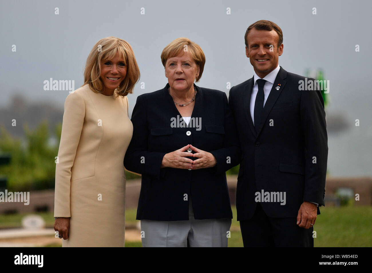 French President Emmanuel Macron And His Wife Brigitte Trogneux Meet German Chancellor Angela Merkel Centre At The Official Welcome During The G7 Summit In Biarritz France Stock Photo Alamy