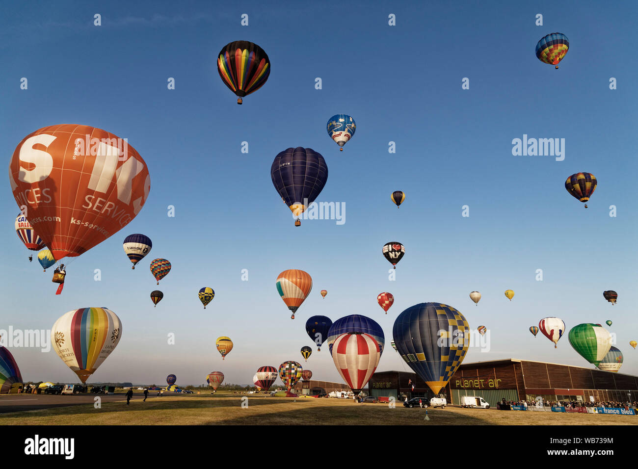 Chambley, France. 4th August, 2019. Hundreds of hot air balloons took off from the Chambley-Bussieres Airbase for the Grand Est Mondial Air Ballons. Stock Photo