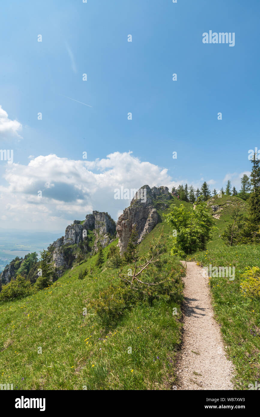 Ostra hill with rocks, meadows and hiking trail in Velka Fatra mountains in Slovakia during beautiful springtime day Stock Photo
