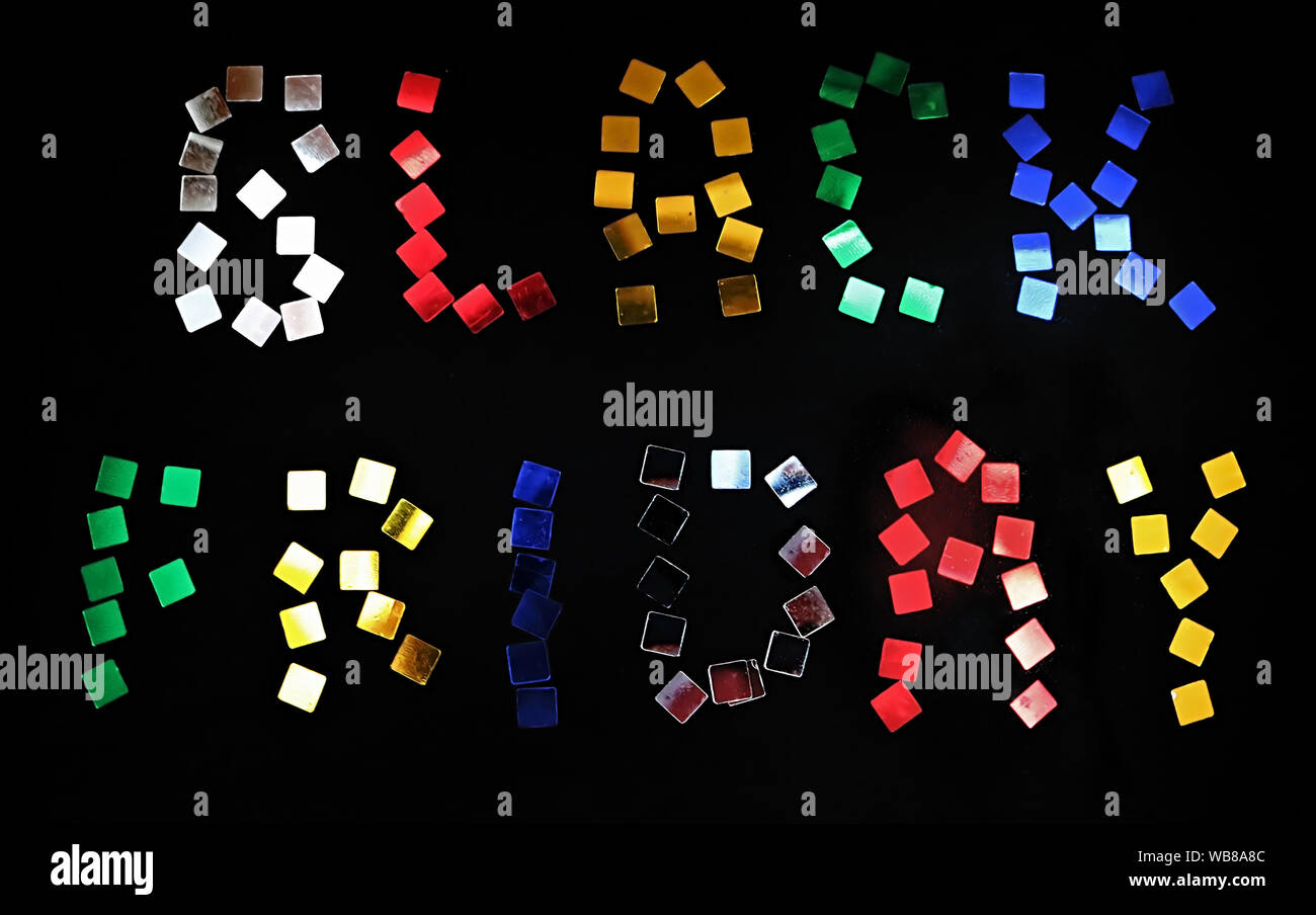 The words BLACK FRIDAY is laid out of colour confetti on black background. Black friday sale concept Stock Photo