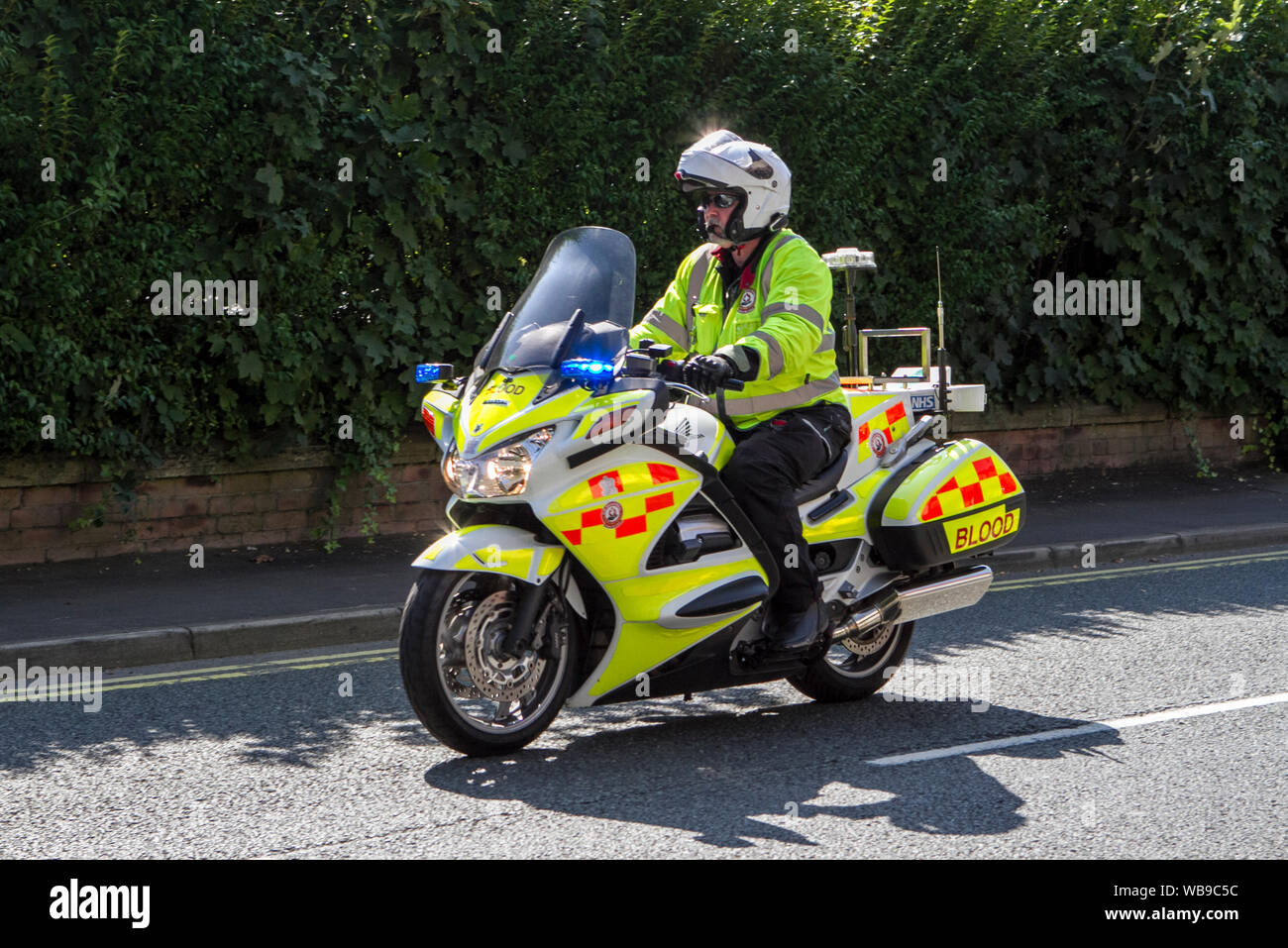 Blood bikes with emergency flashing blue lights, Ormskirk, Lancashire, UK Stock Photo