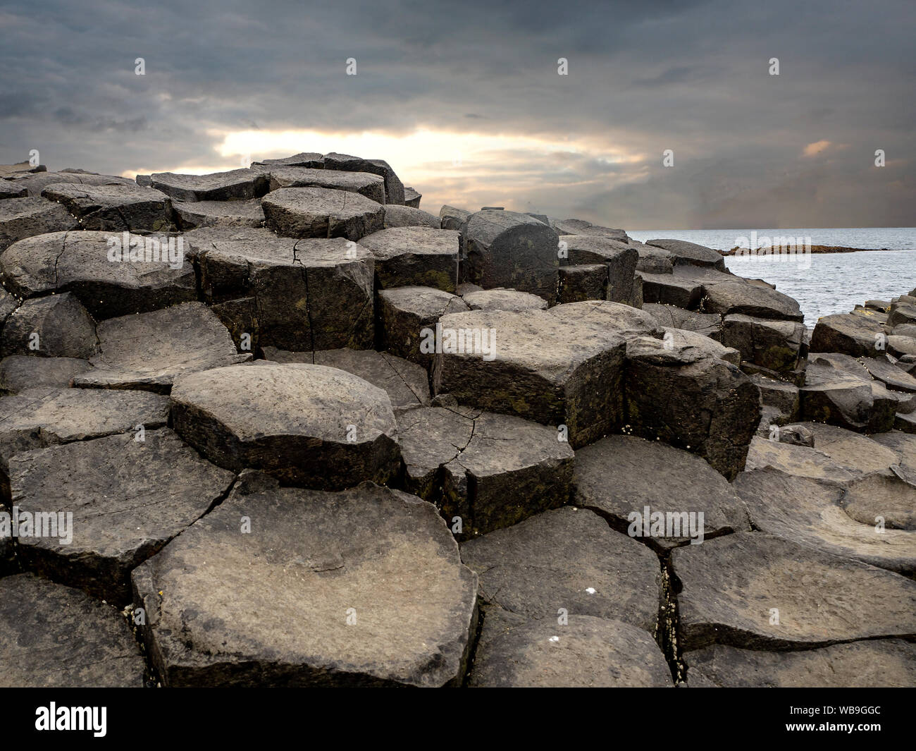 Giant's Causeway,  Northern Ireland, UK. Unique natural hexagonal and pentagonal geological formation of volcanic basalt rocks, resembling cobblestone Stock Photo