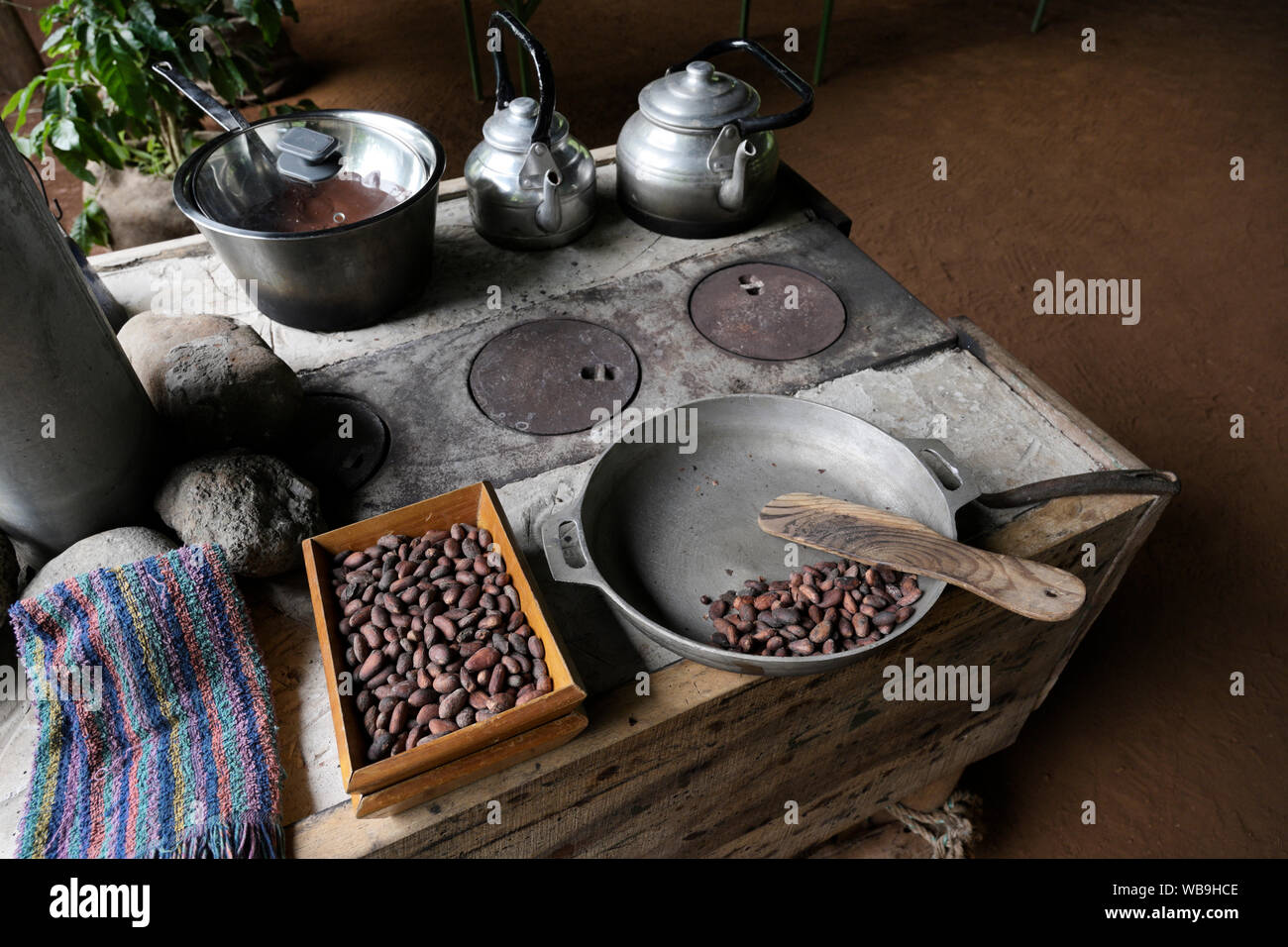 Roasting cacao seeds and making cocoa at a chocolate farm, Costa Rica Stock Photo