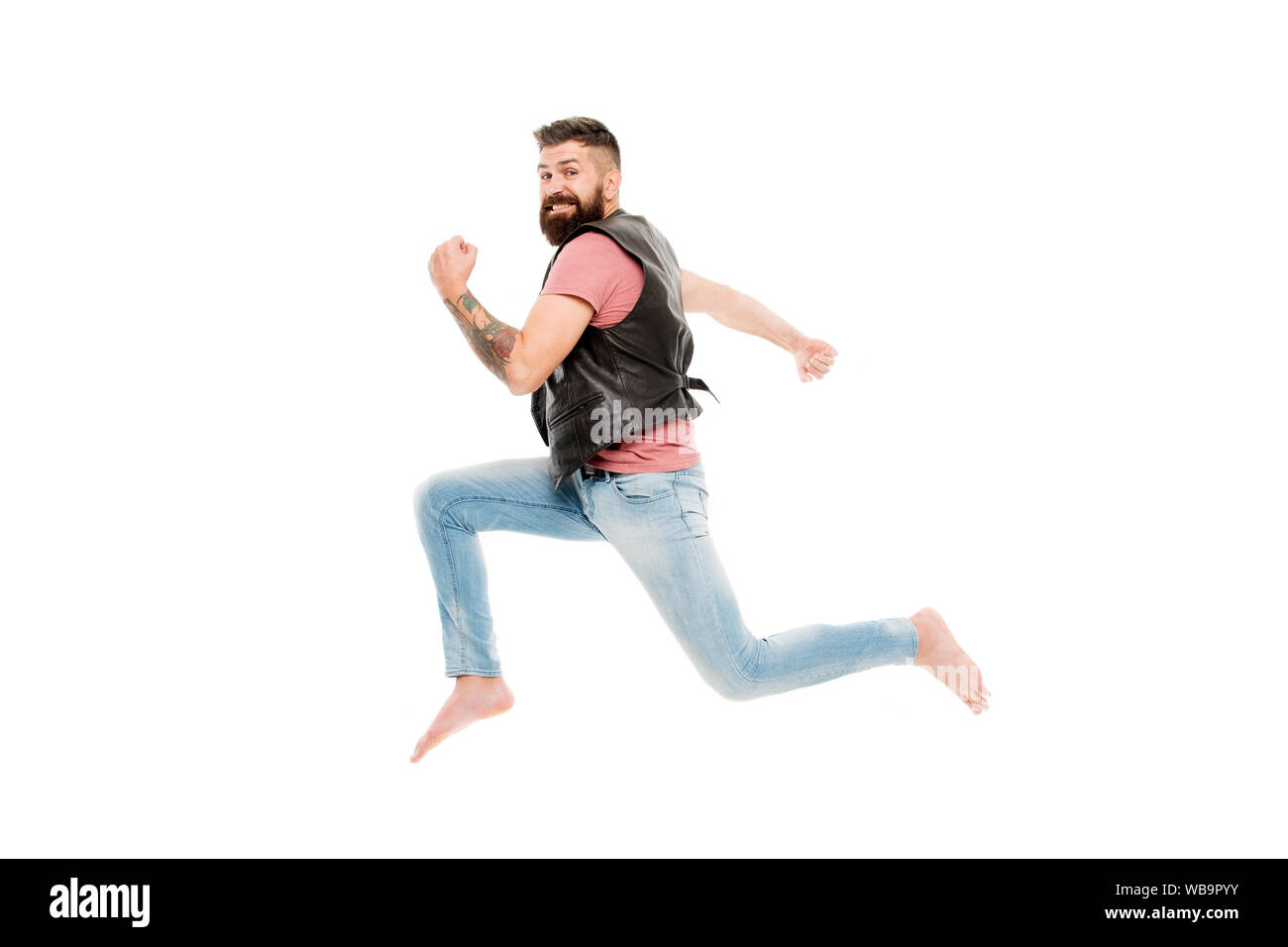 Last chance. Following his dream. Barefoot guy hurries to beach. Run away. Hurry up. Guy happy cheerful face having fun run jumping. Life in motion. Man bearded guy run away. Always in motion. Stock Photo