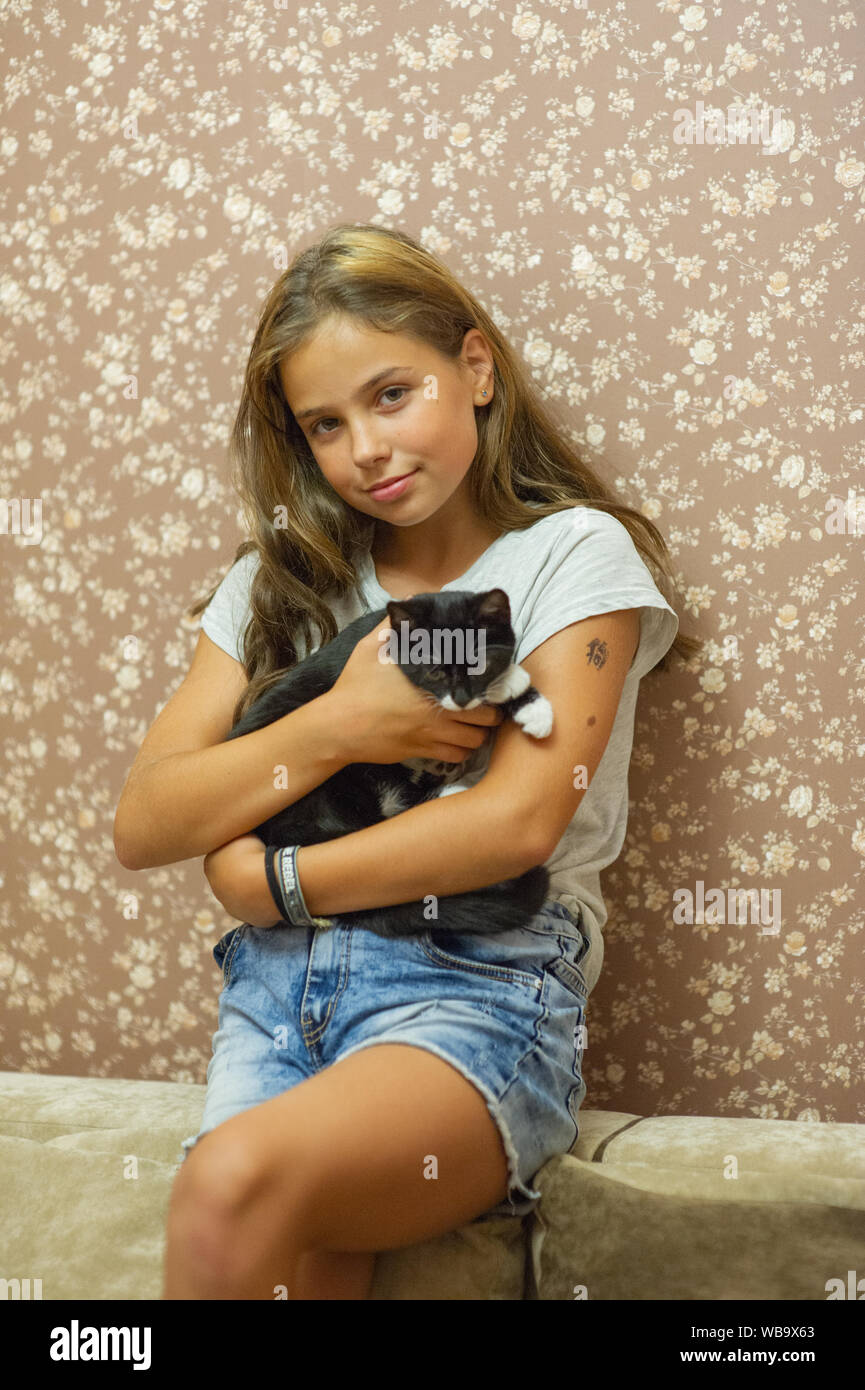 Astonishing Girl 10 Years Old And A Black And White Kitten Beautiful Brunette Natural Hairstyles Runnerswayorg