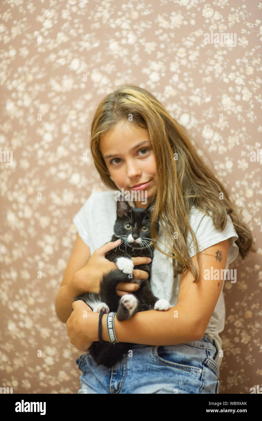 Girl 10 Years Old And A Black And White Kitten Beautiful Brunette Girl And Black Cat