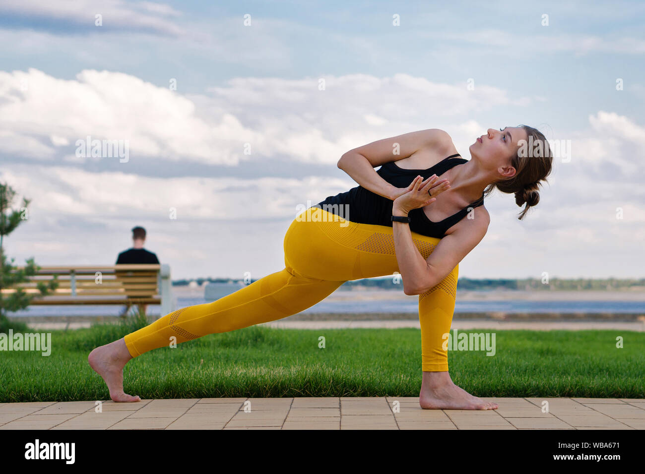 Yoga time. Woman yoga instructor. Handsome athletic woman doing yoga asanas in the park. Enjoy pilates. Girl do muscle stretching. Stock Photo