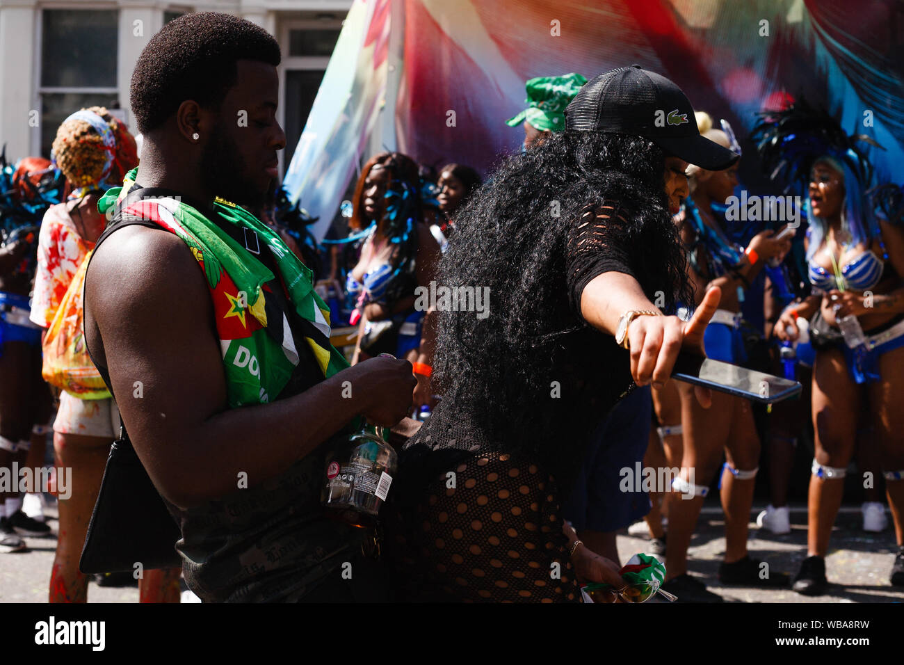 London, UK. 25th Aug, 2019. J'ouvert revellers dance at Ladbroke Grove, during the opening day of the 2019 Notting Hill Carnival.Up to a million people are expected to pack the streets of Notting Hill and surrounding areas over the course of the two day event. The annual celebration of Afro-Caribbean culture takes place each August bank holiday weekend. Credit: SOPA Images Limited/Alamy Live News Stock Photo