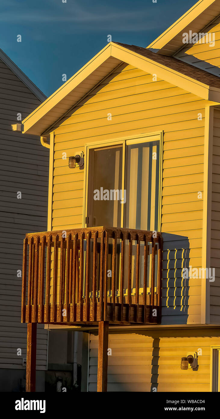 Vertical House Exterior With Close Up View Of The Small Wooden Balcony And Cream Wall Stock Photo Alamy
