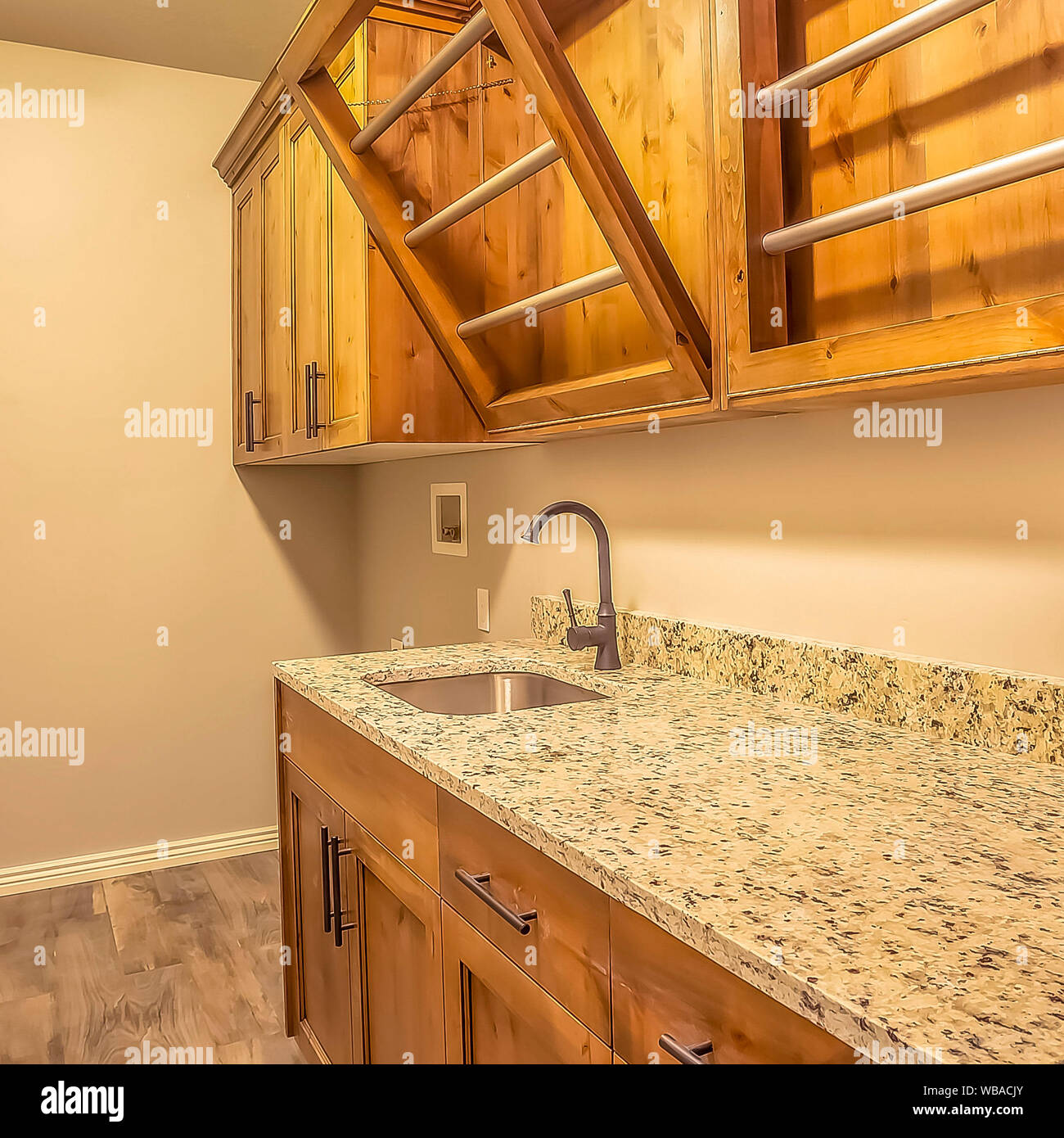 Square Kitchen Interior Of New Home With Dark Wood Cabinets Marble Countertop And Sink Stock Photo Alamy